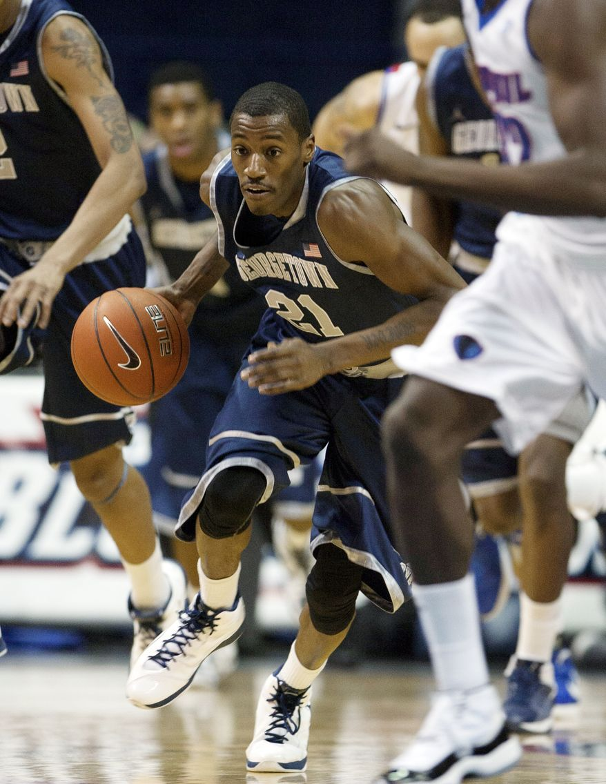 Georgetown's Jason Clark (21) dribbles against DePaul during the first half of an NCAA basketball game in Rosemont, Ill., on Tuesday, Jan. 17, 2012. (AP Photo/Charles Cherney)