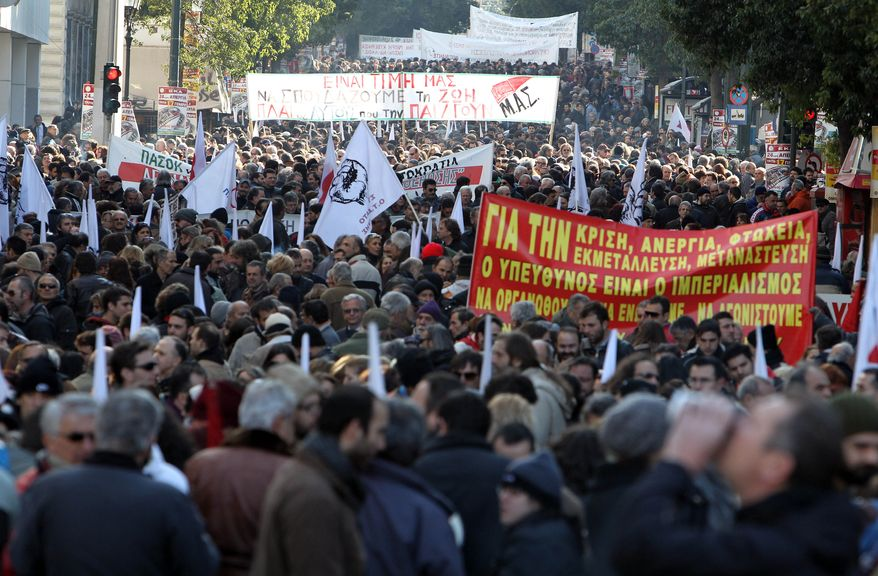 Demonstrators carrying banners with anti-austerity slogans protest during a rally organized by the PAME Communist-affiliated union on Tuesday, Jan. 17, 2012, in Athens. (AP Photo/Thanassis Stavrakis)