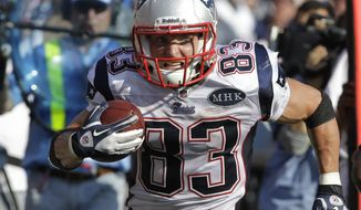 FILE - In this Sept. 25, 2011 file photo, New England Patriots' Wes Welker runs against the Buffalo Bills during the second half of an NFL game in Orchard Park, N.Y. Welker led the NFL in catches and yards receiving, so the Ravens better pay attention in Sunday's AFC title game. (AP Photo/David Duprey, File)