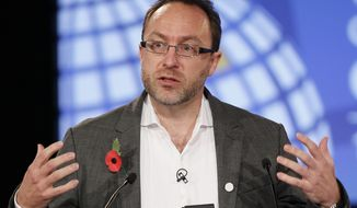 **FILE** Jimmy Wales, founder of Wikipedia, speaks Nov. 1, 2011, during the opening session at the London Cyberspace Conference in London. (Associated Press)