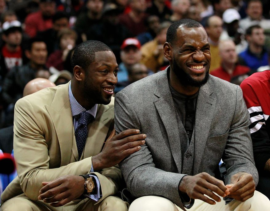 Miami Heat's LeBron James is second in the league behind Kobe Bryant with 29.8 points per game. (Associated Press)