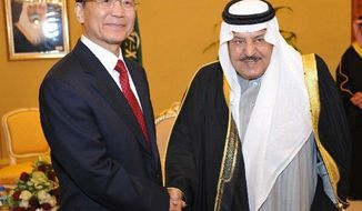 In this photo released by Saudi Press Agency, Saudi crown prince Nayef bin Abdel-Aziz, right, welcomes Chinese Premier Wen Jiabao in Riyadh, Saudi Arabia, Saturday, Jan. 14, 2012. China's premier visits Saudi Arabia as part of six-day Mideast trip that also takes him to the United Arab Emirates and qatar. The visit to the region runs from Jan. 14-19. Wen Jiabao is slated to discuss the Arab Spring uprising and talks are likely to also focus on the latest U.S. sanctions on Iran, a major oil exporter to China. (AP Photo/HO) EDITORIAL USE ONLY, NO SALES