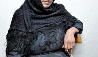 UNDER SIEGE: Mona Hanna says she fears for the future of her town, Abo Korkas, Egypt. She and nine other families fled their homes last year after armed Muslim men set her house afire. (Sarah Lynch/Special to The Washington Times)