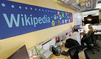 Mallory Whitt works at her desk at the offices of the Wikipedia Foundation in San Francisco on Wednesday. (Associated Press)