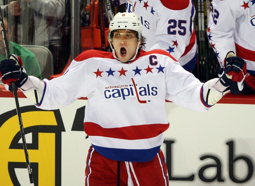 Washington Capitals left wing Alex Ovechkin celebrates after scoring the third goal against the Montreal Canadiens during the second period on Wednesday, Jan. 18, 2012, in Montreal. (AP Photo/Canadian Press, Ryan Remiorz)