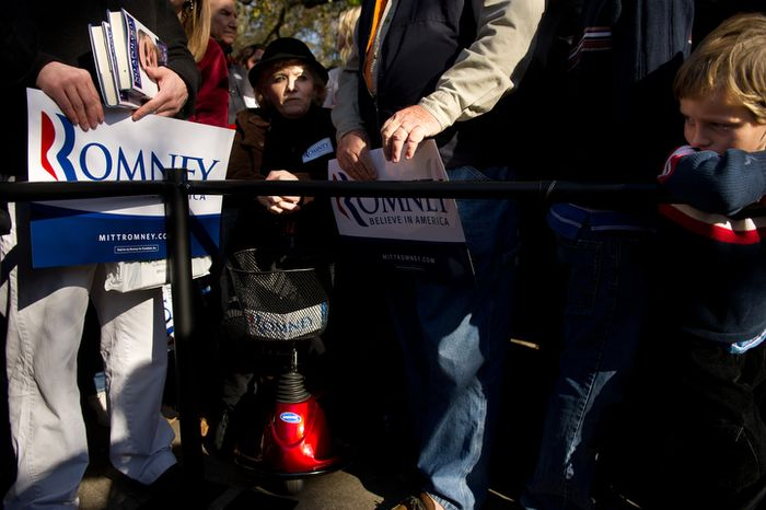 Linda Faulkner (left) of Gray Court, S.C., and 5-year-old Brendan Alvis of Spartanburg, S.C., wait Jan. 18, 2012, along with other supporters for Republican presidential candidate and former Massachusetts Gov. Mitt Romney to arrive at a campaign rally at Wofford College in Spartanburg. (Andrew Harnik/The Washington Times)