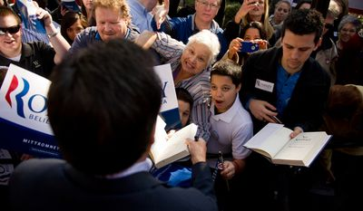 Republican presidential candidate and former Massachusetts Gov. Mitt Romney signs autographs and shakes hands with supporters on Jan. 18, 2012, after speaking at a campaign rally at Wofford College in Spartanburg, S.C. (Andrew Harnik/The Washington Times)