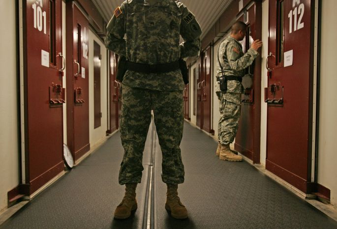 ** FILE ** Military personnel inspect each occupied cell on a two-minute cycle at the Camp 5 maximum-security facility at the U.S. Naval Base at Guantanamo Bay, Cuba, in October 2007. (AP Photo/Brennan Linsley, File)