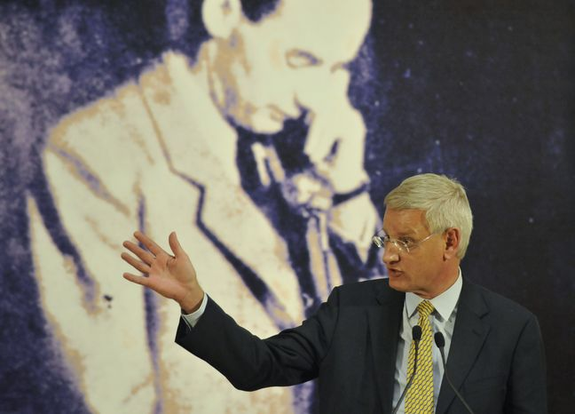 "Swedish Foreign Minister Carl Bildt delivers a speech during the opening of the exhibition ""Man Amidst Inhumanity,"" which remembers World War II hero Raoul Wallenberg, in Budapest on Tuesday, Jan. 17, 2012. (AP Photo/Bela Szandelszky)"