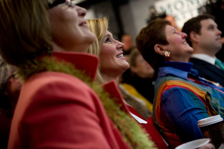 From left: Peggy Morse of Myrtle Beach, S.C., her daughter, Beth Morse Ferguson of Charleston, S.C., and Mary Ann Carnazza of Longs, S.C., listen as Republican presidential candidate and Texas Gov. Rick Perry speaks Jan. 16, 2012, at the Fresh Brewed Coffee House in Myrtle Beach, S.C., to members of CafeMom, a group of politically active South Carolina mothers. (Andrew Harnik/The Washington Times)