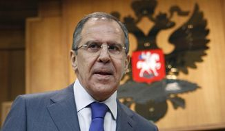 Russian Foreign Minister Sergey Lavrov walks to speak at a news conference in Moscow, Russia, Wednesday, Jan. 18, 2012. (AP Photo/Mikhail Metzel)
