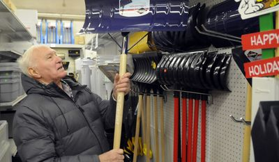 ** FILE ** With the incoming winter storm in mind, Don Mortenson, 77 of Spokane, Wash., checks out an aluminum snow shovel at the General Store, Tuesday, Jan. 17, 2012, in Spokane, Wash. (AP Photo/Dan Pelle, Spokesman Review, File)