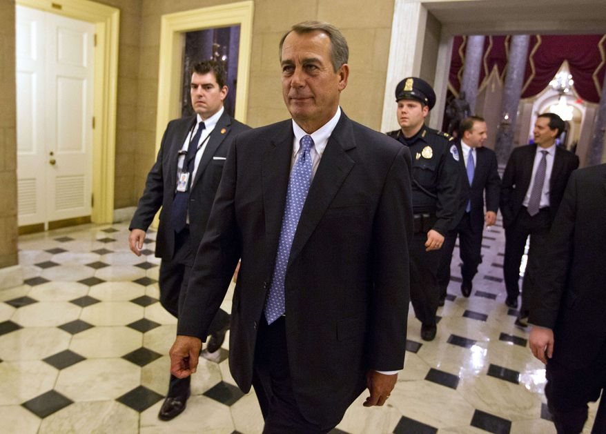 In this Dec. 20, 2011, photo, House Speaker John Boehner of Ohio walks off the floor of the House chamber in Washington. (AP Photo/Evan Vucci)