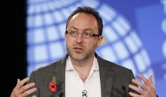 In this Nov. 1, 2011, file photo, Jimmy Wales, founder of Wikipedia speaks during the opening session at the London Cyberspace Conference in London. (AP Photo/Kirsty Wigglesworth, file pool)