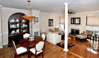 The dining and living rooms are open to each other. The living room has a wood-burning fireplace.