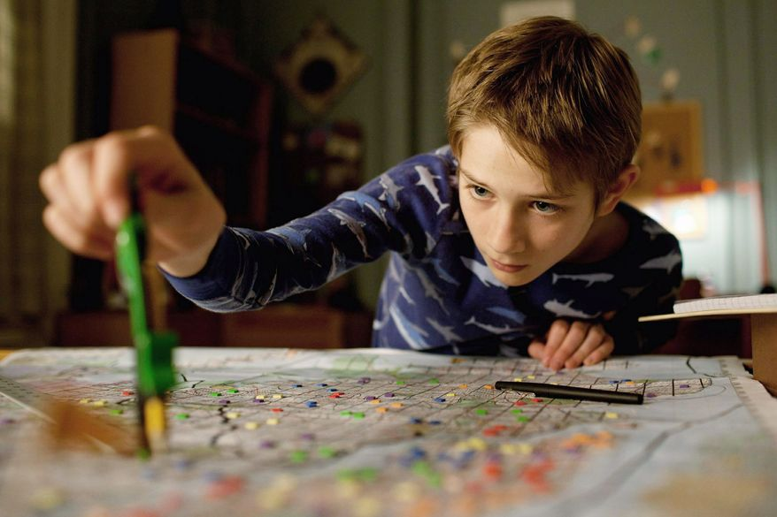 """Thomas Horn as Oskar Schell hopes to find something to help him connect with the father he lost in the Sept. 11 attacks in """"Extremely Loud & Incredibly Close."""" (Warner Bros. Pictures via Associated Press)"""