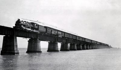 Henry Flagler's Florida Keys Over-Sea Railroad train rolls on the Seven Mile Bridge near Marathon, Fla. The centennial anniversary of the first train's arrival into Key West and the completion of the Over-Sea Railroad project will be marked on Jan. 22, 2012. (Associated Press)