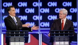 Former Massachusetts Gov. Mitt Romney (left) makes a point as former House Speaker Newt Gingrich listens during the Republican presidential candidate debate at the North Charleston Coliseum in Charleston, S.C., on Thursday. (Associated Press)