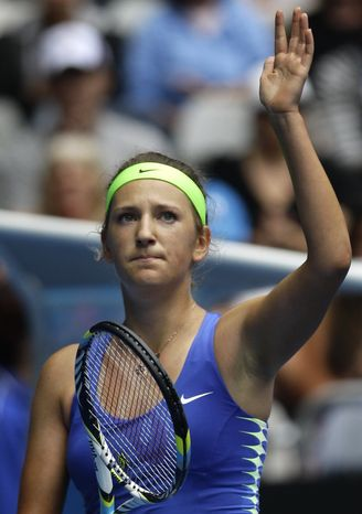 Victoria Azarenka celebrates after defeating Mona Barthel during their third-round match at the Australian Open, in Melbourne, Australia, Friday, Jan. 20, 2012. (AP Photo/Rick Rycroft)