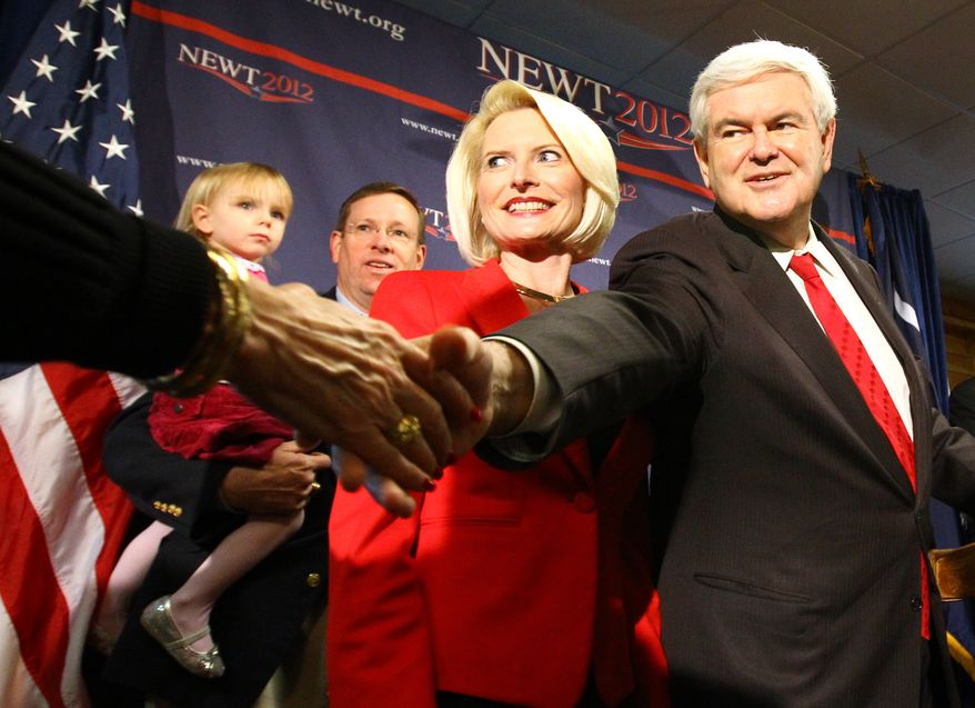 Former House Speaker Newt Gingrich shakes hands with supporters while standing with his third wife, Callista, before speaking at Mutt's Barbeque in Easley, S.C., on Wednesday, Jan. 18, 2012. (AP Photo/The Independent-Mail, Nathan Gray)