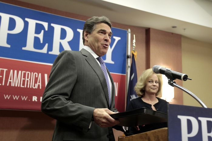 Texas Gov. Rick Perry and his wife, Anita, arrive for a news conference in North Charleston, S.C., on Thursday, Jan. 19, 2012, at which he announced the suspension of his GOP presidential campaign and his endorsement of former House Speaker Newt Gingrich. (AP Photo/David Goldman)
