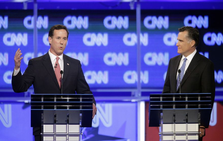 Republican presidential candidates, former Pennsylvania Sen. Rick Santorum and former Massachusetts Gov. Mitt Romney participate in the Republican presidential candidate debate at the North Charleston Coliseum in Charleston, S.C., Thursday, Jan. 19, 2012. (AP Photo/David Goldman)