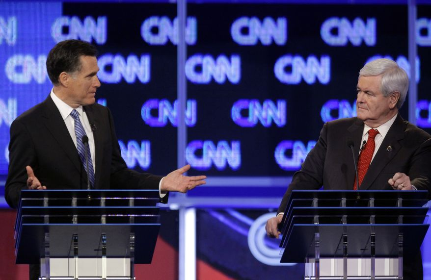 Republican presidential candidates, former Massachusetts Gov. Mitt Romney and former House Speaker Newt Gingrich participate in the Republican presidential candidate debate at the North Charleston Coliseum in Charleston, S.C., Thursday, Jan. 19, 2012. (AP Photo/David Goldman)