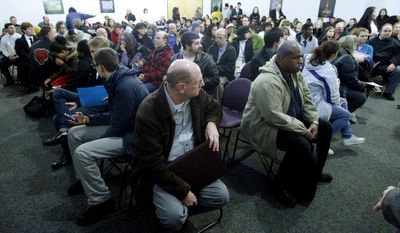 David Morgan (center), 58, of Oregon City, Ore., waits with other job applicants to talk with recruiters during a Safeway Job Fair in Portland, Ore., on Thursday, Jan. 12, 2012. (AP Photo/Rick Bowmer)