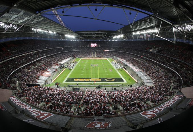 FILE - In this Sunday, Oct. 23, 2011 file photo Tampa Bay Buccaneers and Chicago Bears play during the first half of an NFL football game at Wembley Stadium in London. The NFL said Friday Jan. 20, 2012, the Rams and Patriots will play on Oct. 28, 2012 at Wembley Stadium, the sixth year in a row the league will play regular-season games in the British capital. (AP Photo/David Azia, File)