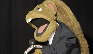 A puppet reporter is shown Jan. 19, 2012, during taping at WOIO-TV in Cleveland. The station uses the puppets performing as witnesses, reporters and jurors to detail the corruption trial against former Cuyahoga county commissioner Jimmy Dimora, which began last week in federal court in Akron. (Associated Press)