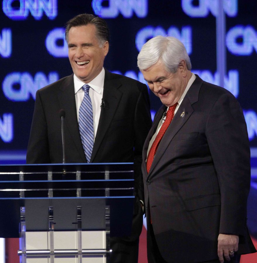 ** FILE ** Republican presidential candidates, former Massachusetts Gov. Mitt Romney and former House Speaker Newt Gingrich share a laugh during a commercial break at the Republican presidential candidate debate at the North Charleston Coliseum in Charleston, S.C., Thursday, Jan. 19, 2012. (AP Photo/David Goldman)