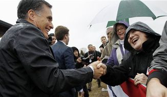 Republican presidential candidate, former Massachusetts Gov. Mitt Romney shakes hands with supports during a campaign stop at Harmon's Tree Farm in Lexington, S.C., Friday, Jan., 20, 2012. (AP Photo/Pablo Martinez Monsivais)