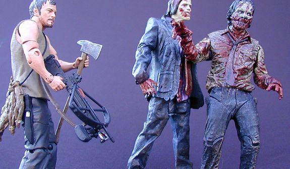 McFarlane Toys' Daryl Dixon sizes up the Zombie Walker and Zombie Biter. (Photograph by Joseph Szadkowski / The Washington Times)
