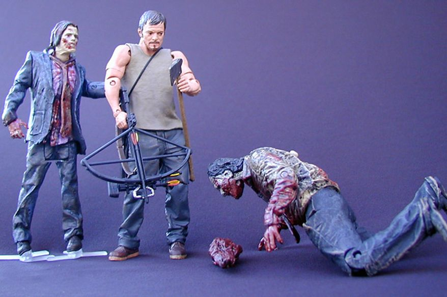 McFarlane Toys' Daryl Dixon gets ready to take care of the Zombie Biter while the Zombie Walker sneaks up on him. (Photograph by Joseph Szadkowski / The Washington Times)