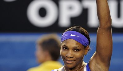 Serena Williams celebrates after defeating Greta Arn during their third-round match at the Australian Open, in Melbourne, Australia, Saturday, Jan. 21, 2012. (AP Photo/Andrew Brownbill)