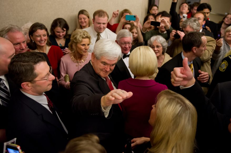 Former House Speaker Newt Gingrich waves to a supporter as he makes his way to deliver his victory speech after winning South Carolina's Republican primary, at the Hilton Columbia Center, Columbia, S.C., Saturday, Jan. 21, 2012. (Andrew Harnik/The Washington Times)