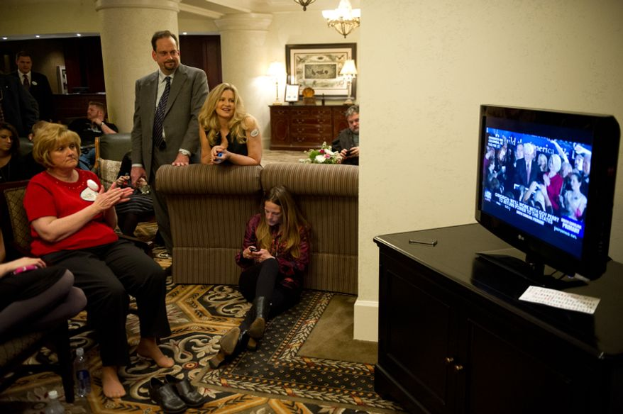 Supporters watch former House Speaker Newt Gingrich deliver his victory speech on television at the Hilton Columbia Center's lobby, Columbia, S.C., Saturday, Jan. 21, 2012. (Andrew Harnik/The Washington Times)