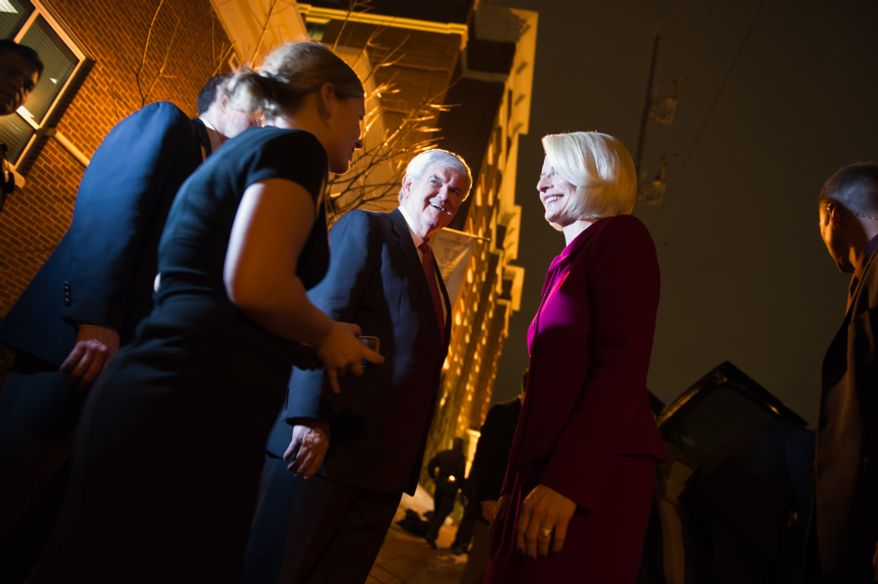 Former House Speaker Newt Gingrich and his wife Callista, right, speak to a friend as he departs for his victory party after winning South Carolina's Republican primary, at the Hilton Columbia Center, Columbia, S.C., Saturday, Jan. 21, 2012. (Andrew Harnik/The Washington Times)
