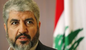 ** FILE ** In this Jan. 15, 2010, file photograph, Hamas leader Khaled Mashaal speaks to journalists after his meeting with Lebanese Prime Minister Saad Hariri in Beirut, Lebanon. Mashaal won't seek re-election, Hamas announced Saturday, paving the way for a leadership contest and possible struggle over the ideological direction of the Islamic militant group. (AP Photo/Hussein Malla, File)