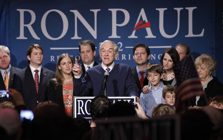 ** FILE ** Republican presidential candidate Rep. Ron Paul, R-Texas, center, is joined on stage with members of his family during his South Carolina presidential primary election night rally in Columbia, S.C., Saturday, Jan., 21, 2012. Former House Speaker Newt Gingrich won the Republican primary that night. (AP Photo/Pablo Martinez Monsivais)