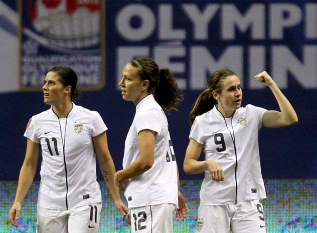 United States' Heather O'Reilly (9) celebrates her goal with teammates Lauren Cheney (12) and Ali Krieger (11) during the first half of a CONCACAF women's Olympic qualifying soccer match against the Dominican Republic in Vancouver, British Columbia, Friday, Jan. 20, 2012. (AP Photo/The Canadian Press, Jonathan Hayward)