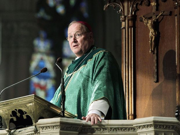 ** FILE ** Archbishop Timothy Dolan of New York, a cardinal-designate, celebrates Mass at St. Patrick's Cathedral in New York on Sunday, Jan. 22, 2012. (AP Photo/Seth Wenig)