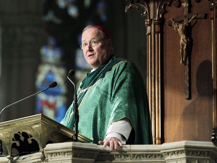 ** FILE ** Archbishop Timothy Dolan of New York, a cardinal-designate, celebrates Mass at St. Patrick's Cathedral in New York on Sunday, Jan. 22, 2012. (AP Photo/Seth Wenig)