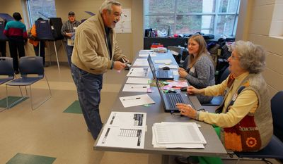 Thomas Pounds of Anderson, S.C., checks in to vote in the South Carolina Republican primary with poll manager Mae Kellam (right) at the Anderson Recreation Center in Anderson, S.C., on Saturday, Jan. 21, 2012. (AP Photo/Anderson Independent-Mail, Ken Ruinard)