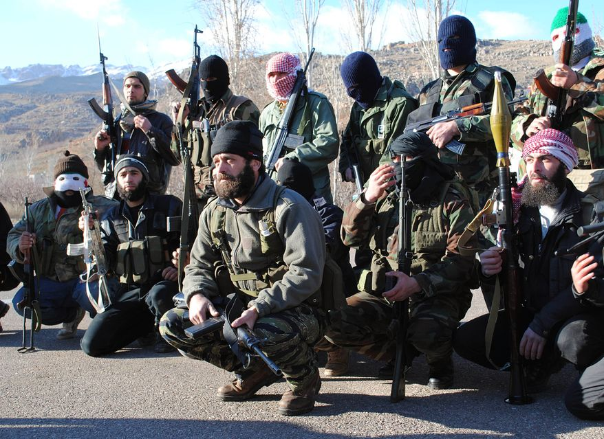 Syrian army defectors gather at the mountain resort town of Zabadani, Syria, near the Lebanese border, on Friday, Jan. 20, 2012. President Bashar Assad's forces attacked Zabadani for six days, sparking fierce fighting that involved heavy bombardments and clashes with the defectors. (AP Photo)
