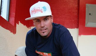 "Rob Van Winkle, also know as Vanilla Ice, lays flooring in the garage of a home he's remodeling in Wellington, Fla. After his early 1990 stardom faded, he became involved in real estate. He is starting in ""The Vanilla Ice Project"" a home renovation show, where the expert just happens to be Vanilla Ice. (Associated Press)"