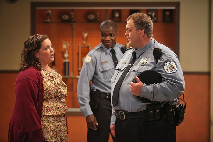 """Melissa McCarthy and Billy Gardell (right) trade raunchy one-liners as Reno Wilson looks on in a scene from """"Mike & Molly,"""" one of four Monday night CBS sitcoms. (CBS Entertainment via Associated Press)"""