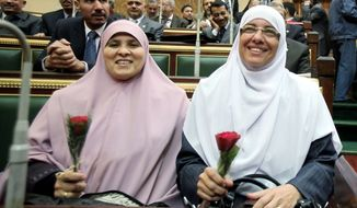 Female People's Assembly members from the Muslim Brotherhood's Freedom and Justice Party attend the chamber's opening session.