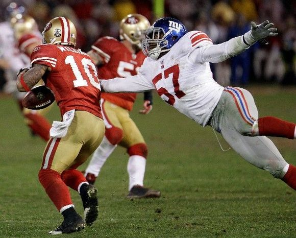 Two gaffes by San Francisco punt returner Kyle Williams - a muffed punt and  this fumble in overtime - led to 10 of the New York Giants' 20 points in the NFC championship game. (Associated Press_