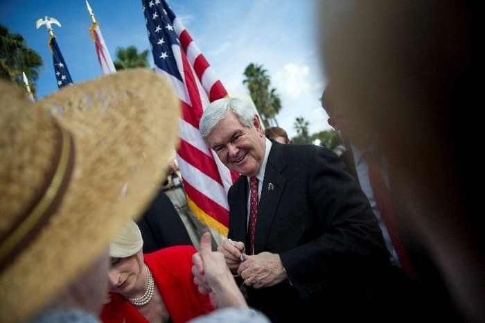 THUMBS UP: With the Florida presidential primary a little more than a week away, former House Speaker Newt Gingrich, a Republican presidential candidate, greets supporter Diana Byther of Largo, Fla., after his campaign stop on Monday at the River at Tampa Bay Church in Tampa, Fla. (Rod Lamkey Jr./The Washington Times)